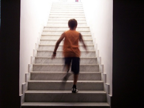 Child running up the stairs