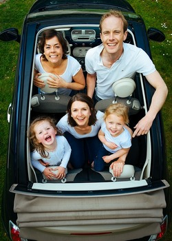 A happy family in a car