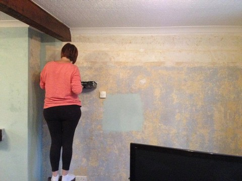Preparing home walls for painting job